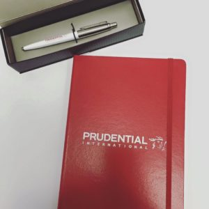 Hard cover branded notebook with elastic bookmark